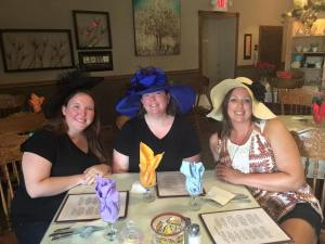Wearing our fancy hats to Tea Thyme.